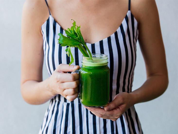 woman-holding-celery-juice-smoothie-732x