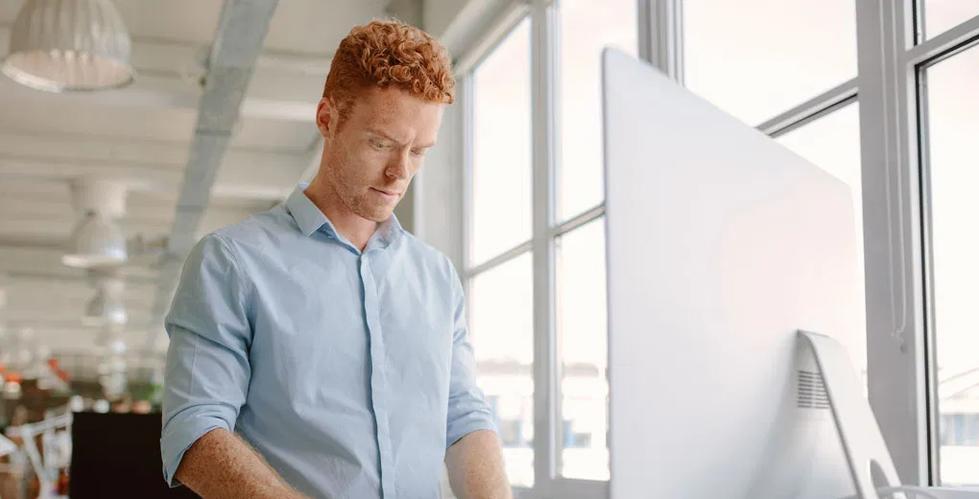 man-working-at-standing-desk.webp