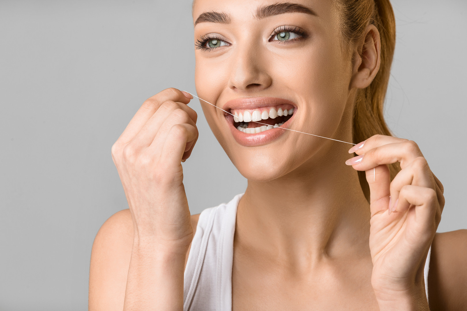 tooth-care-young-woman-using-dental-flos
