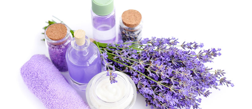 spa-products-and-lavender-flowers-on-a-w