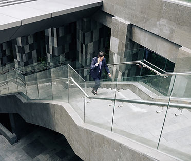 businessman-running-up-the-stairs-ZBGZUG