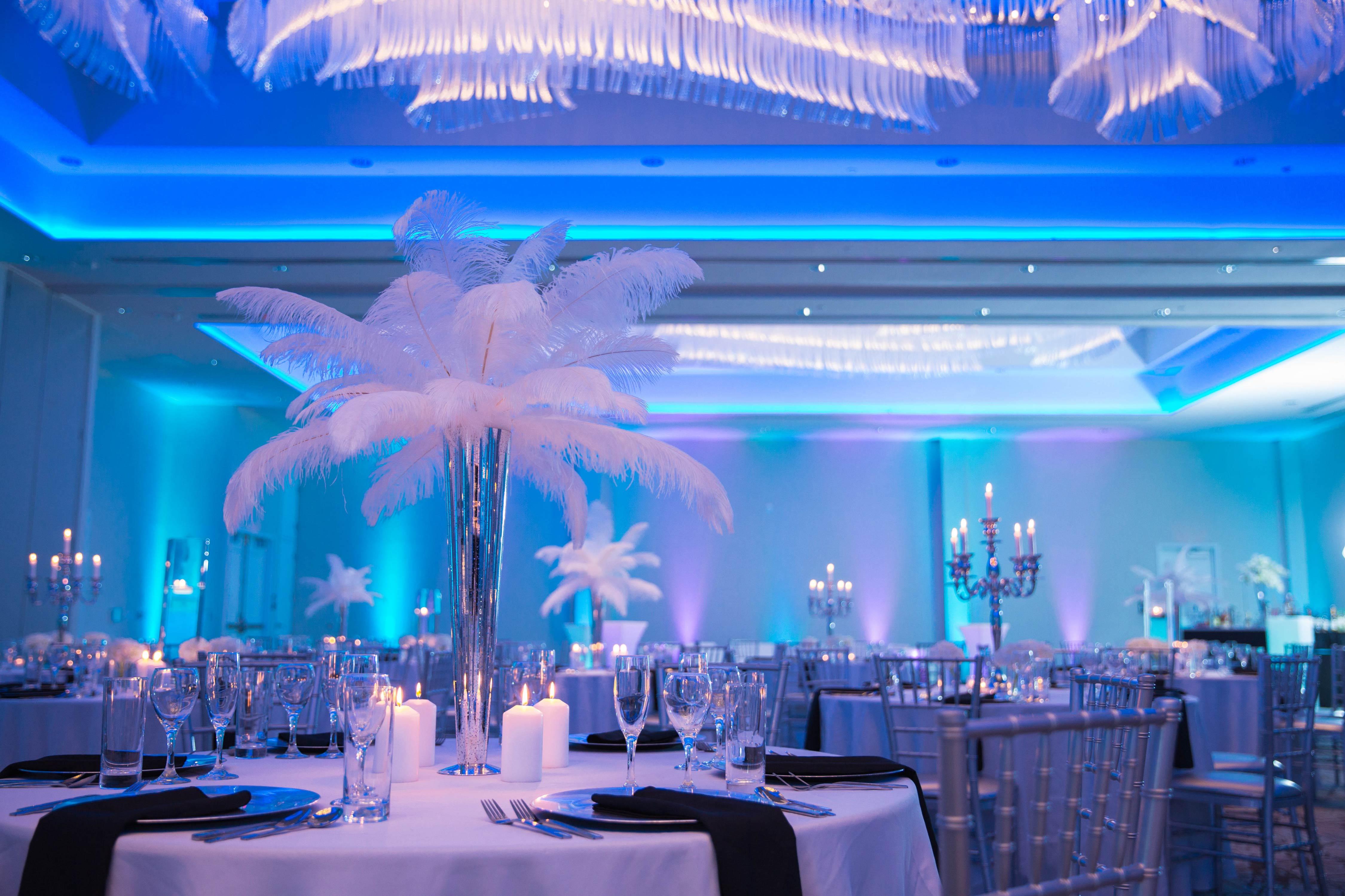 Ballroom lit blue for wedding