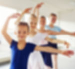 young-ballerinas-dancing-and-looking-at-