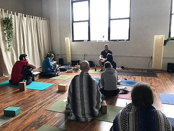 AlexTerranova leading a workshop at a yoga studio
