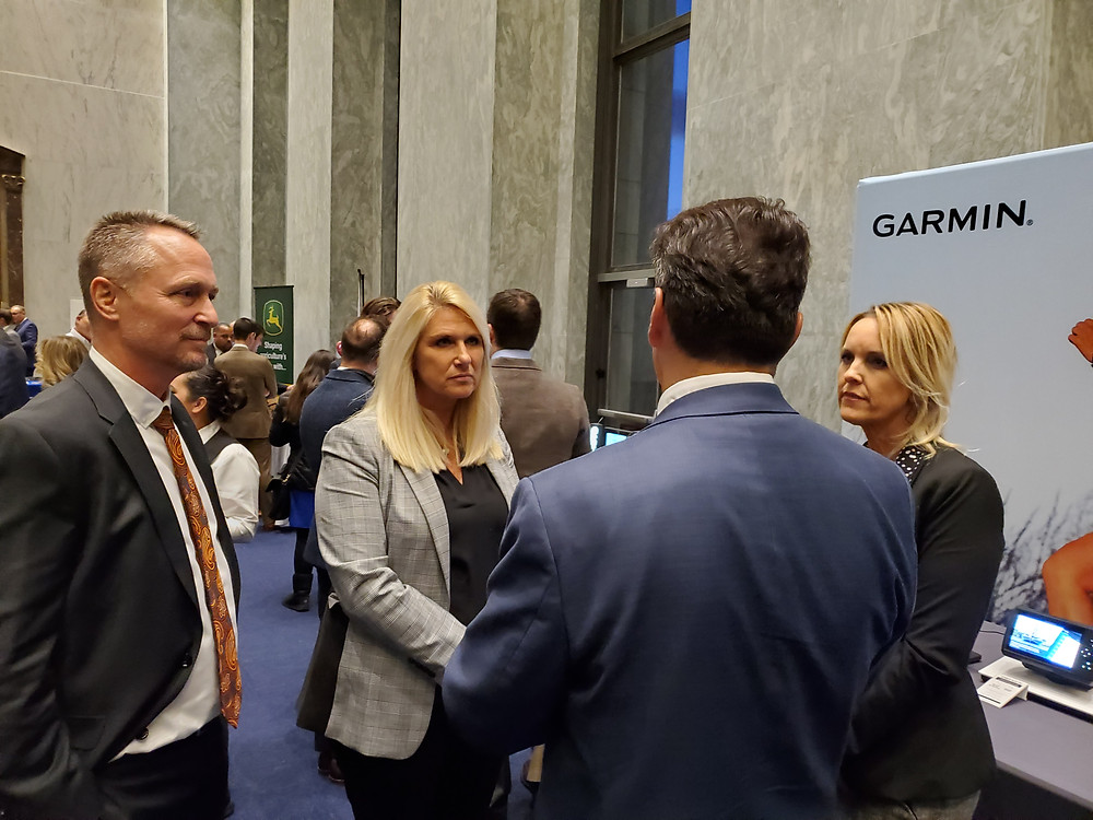 Representatives of Garmin speaking to an attendee