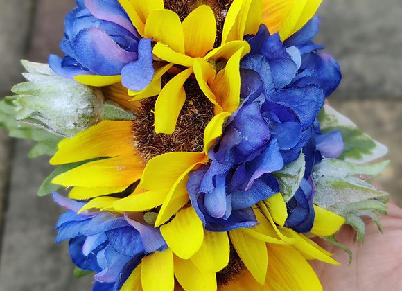 Triple sunflower and delphinium hair flower