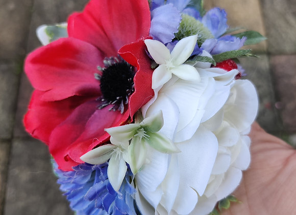 Red, white and blue hairflower with berries