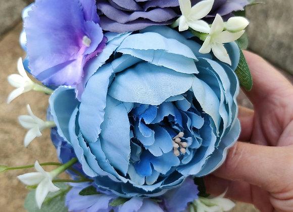 Large blues hair flower