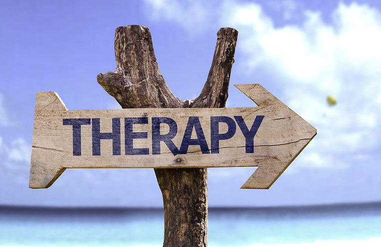 Therapy wooden sign with a beach on back
