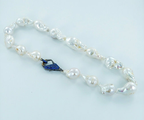 White keshi pearl necklace with blue cz clasp