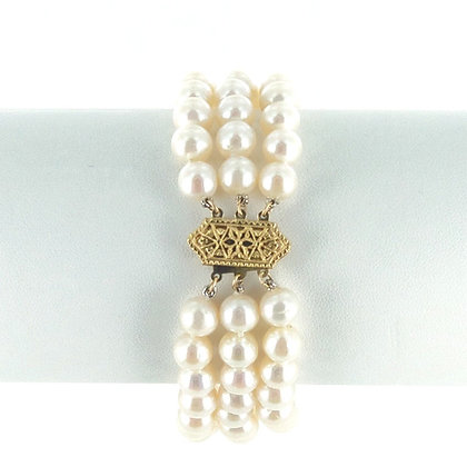 Triple strand white pearl bracelet