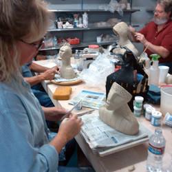 Students working on handbuilding their sculptures