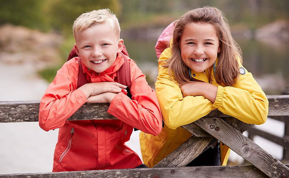bigstock-Two-children-leaning-on-a-wood-