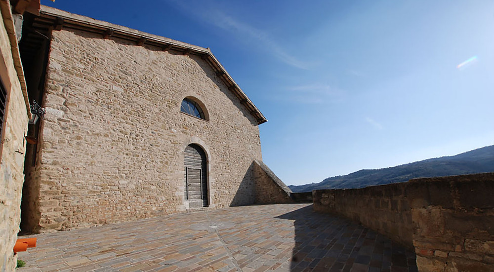 The Church of Torre del Colle with the amazing Belvedere towards the Umbrian Valley. From here you can see Assisi and tenuta Castelbuono