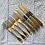 Thumbnail: Kuchenbesteck in goldigem Messing
