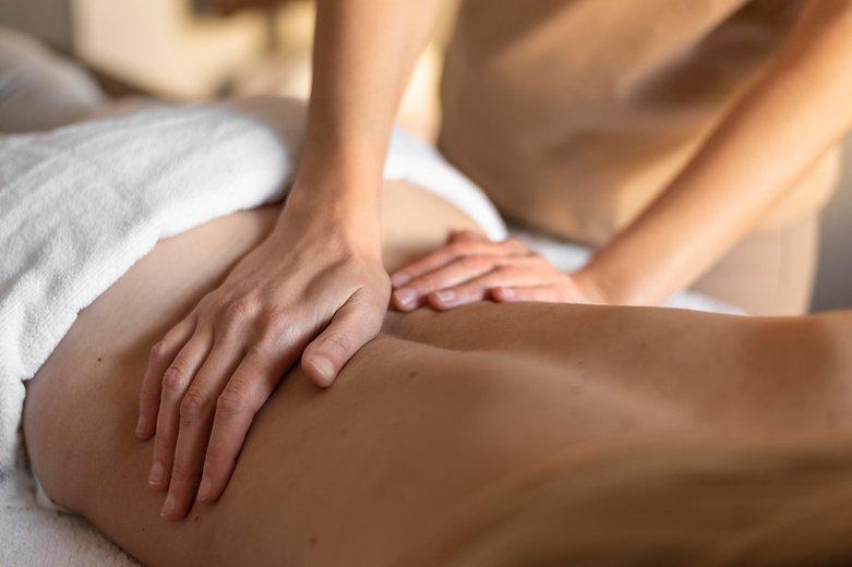 close-up-hands-massaging-person-s-back.j