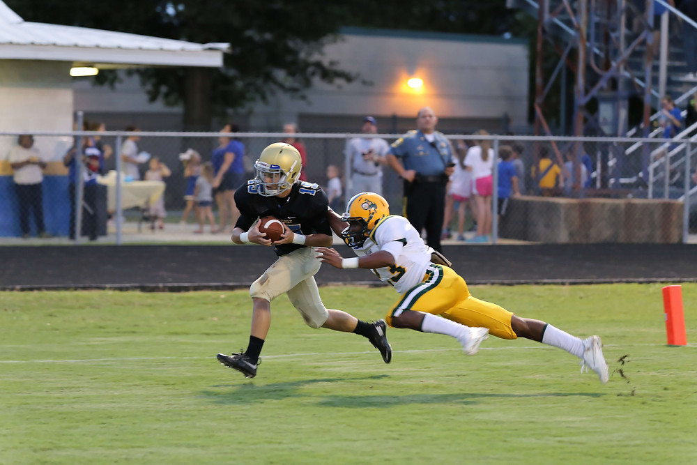 Vandebilt Catholic receiver Kane Degruise catches a touchdown pass in an early season game against Central Lafourche.