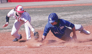 Brown reaches to make the tag.jpg