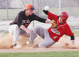 Kyler Beshears slides into third.jpg