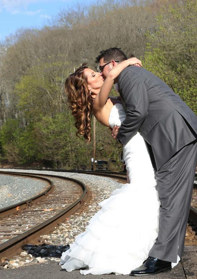 Happy Couple on Railroad tracks
