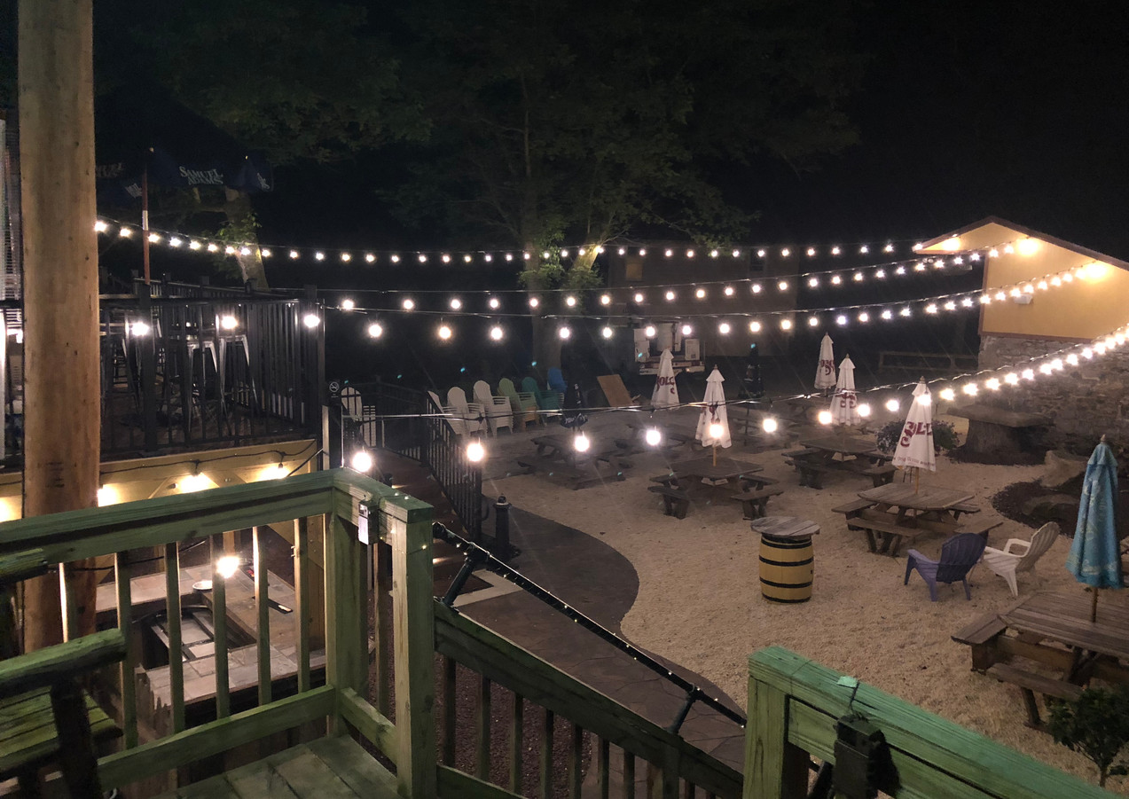 our beautiful patio area lit up at night. Perfect for an evening event!