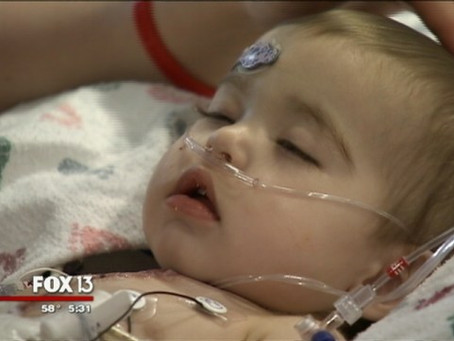 Baby recovering after heart transplant