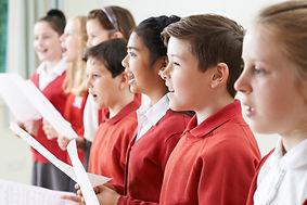 Group Of Children Singing In School Choi