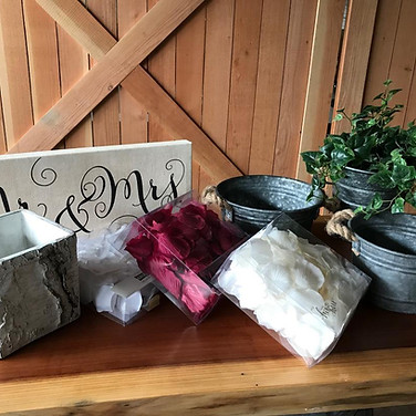 Small Mr._ Mrs. sign, 1 birch flower pot, 3 flower girl rose pettles white, ivory and burgandy and 3 tins