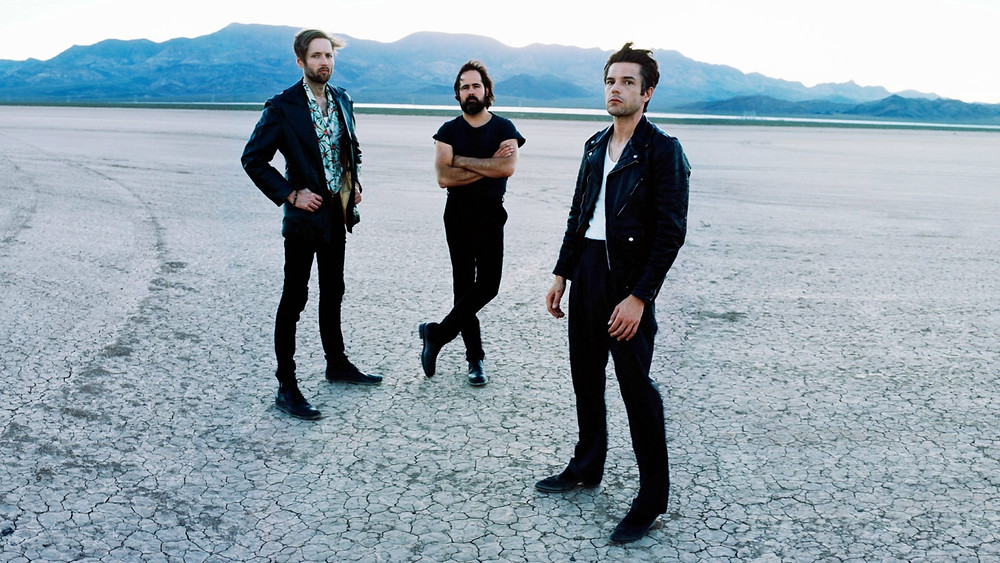 The Killers standing in the desert