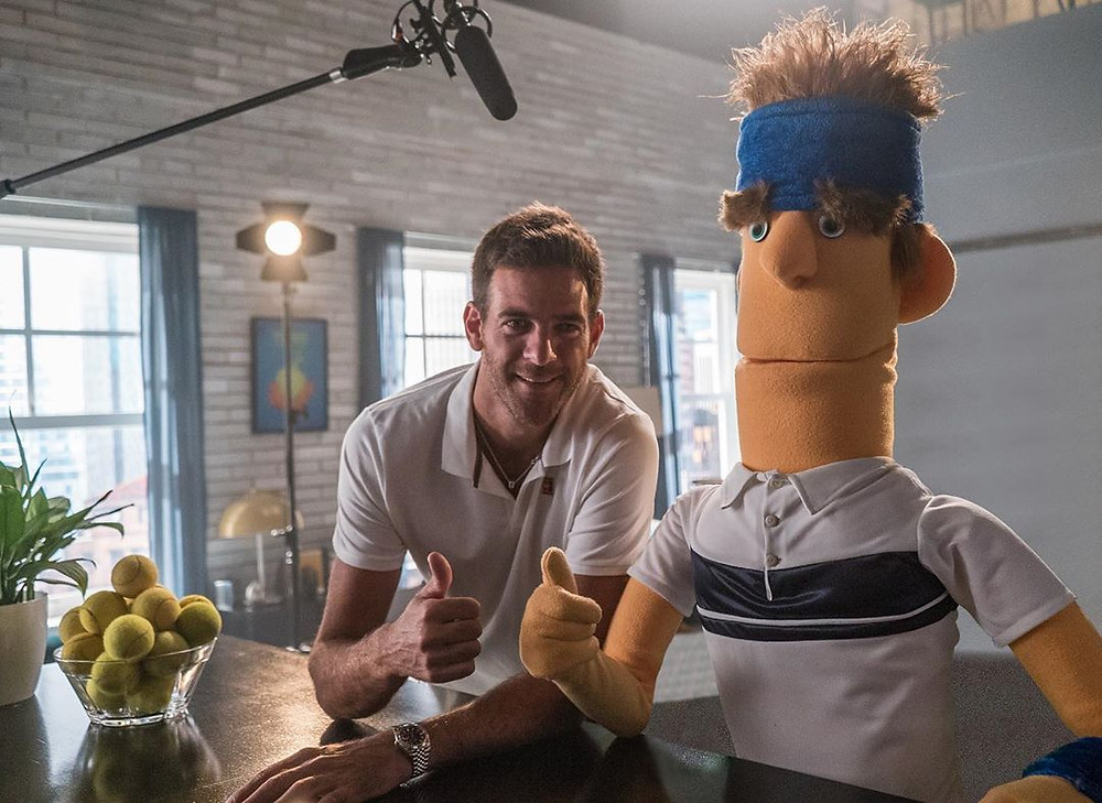 Juan Del Potro giving a thumbs up beside of muppet of himself