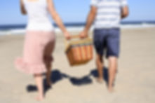 Couple walking with picnc basket - link to services