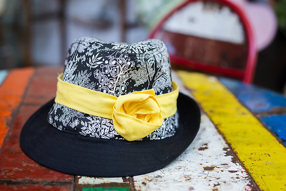 Black and white floral  trilby with yellow trim