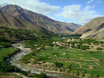 Agricultural plain in river valley with village in the hills.jpg