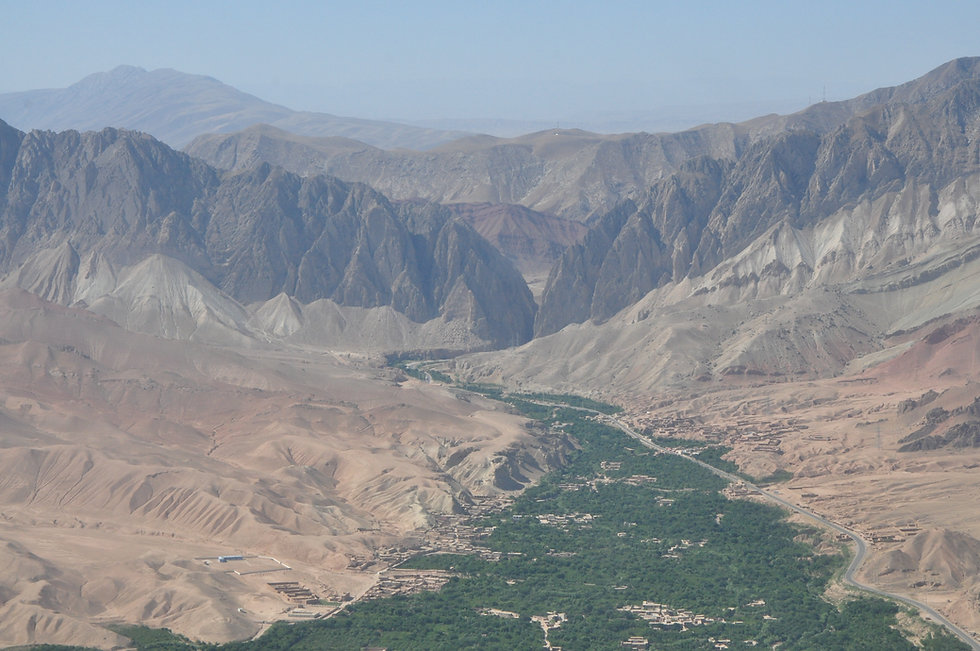 1 Heli photo of village, green valley, and mountain background.JPG