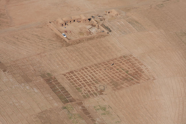 Aerial photo of a compound and farm with