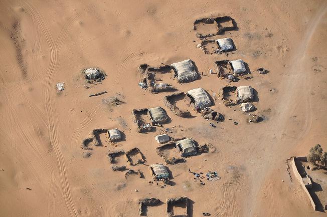Heli photo of Kuchi settlement.JPG