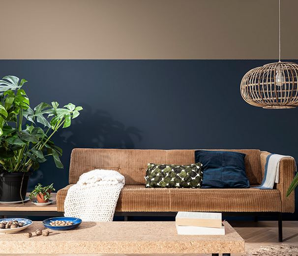 Living room display using the earth colour palette featuring Brave Ground colour of the year 2021