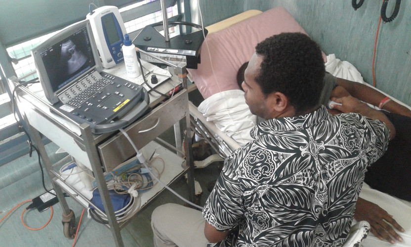 Intern Vanua Ilo with patient.jpg