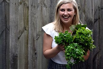 Rachel Larsson, holistic gut health Melbourne naturopath holding a bunch of herbs