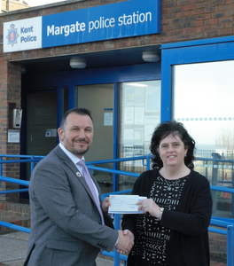 Detective Chief Inspector Tristan Kluibenschadl from the Kent & Essex Serious Crime Directorate presenting Wendy Boorman - Autism Information Advisor from the Kent Autistic Trust (KAT), a cheque from the Kent Police property fund.