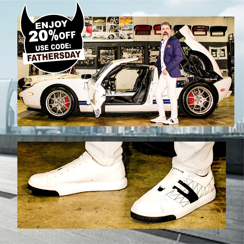Dad models with luxury sports car and wears chic, modern, black and white leather sneakers from KRUZIN.