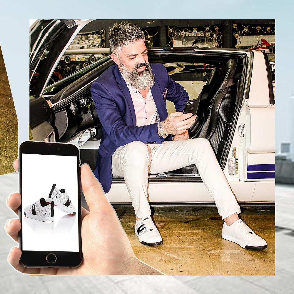 Dad shops online for black and white Crazy Horse Low mens sneakers on KRUZIN website while sitting in expensive, white sports car.
