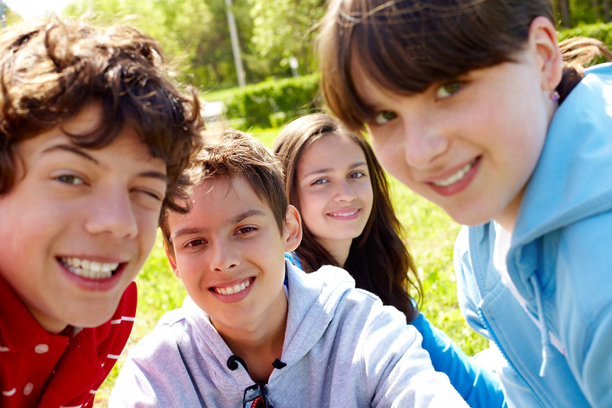 graphicstock-portrait-of-happy-teens-looking-at-camera-in-the-park-at-summer_H6g__q-4W-SBI