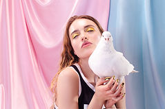 Girl Posing with a Dove