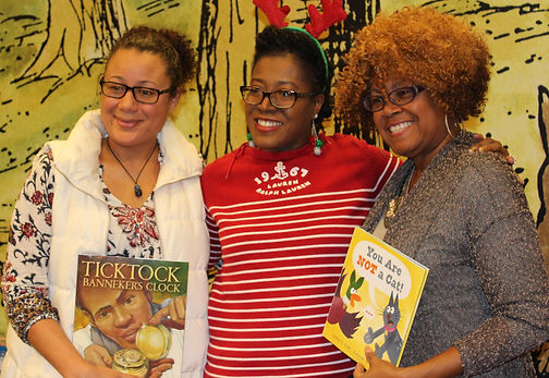Colfax Elementary school librarian posing with author Shana Keller and Sharon G. Flake