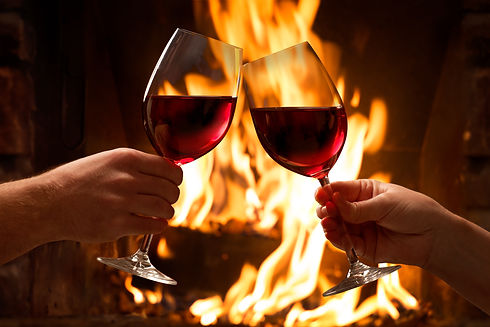 Hands toasting wine glasses in front of
