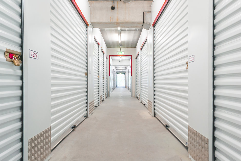 Hallway with white storage units. Concre