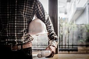Smart Businessman holding construction h