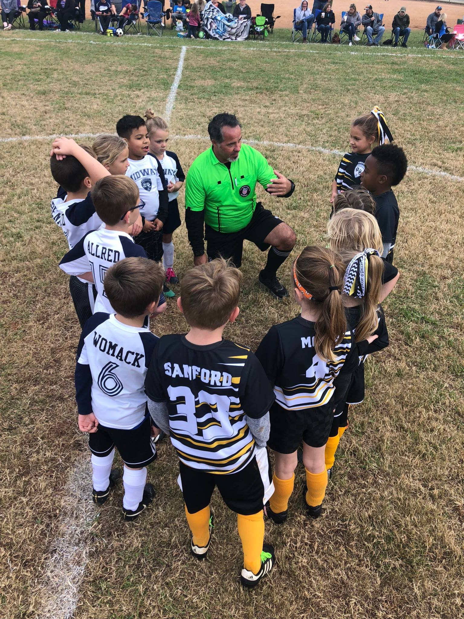 Jason taking time with the U8 group