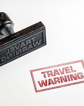 Rubber stamping that says 'Travel Warnin